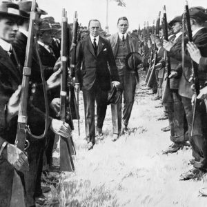 """Unknown author, """"The Road To War"""". Sir Edward Carson inspecting members of the Ulster Volunteer Force. Courtesy of the Imperial War Museums [http://www.iwm.org.uk/collections/item/object/205184076] digital ID Q 81759, © IWM (Q 81759)"""